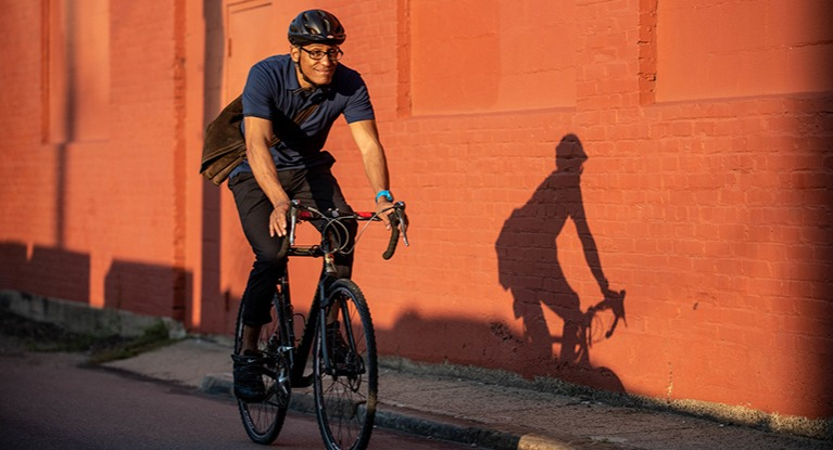 Man riding bike with new helmet