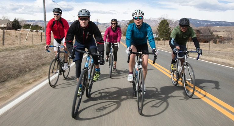 Group of people riding road bikes