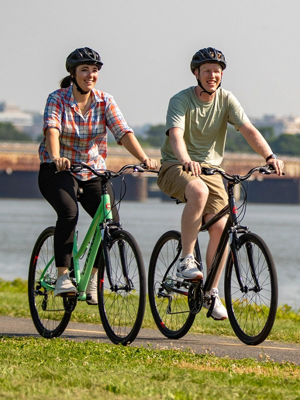 Man and woman on hybrid bike