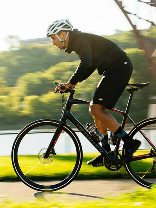 Man on hybrid bike