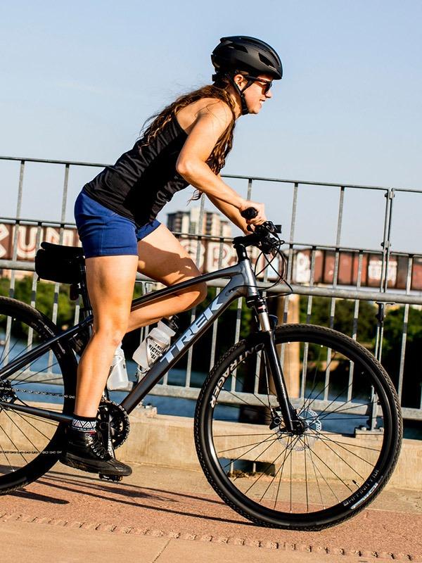 Woman on hybrid bike