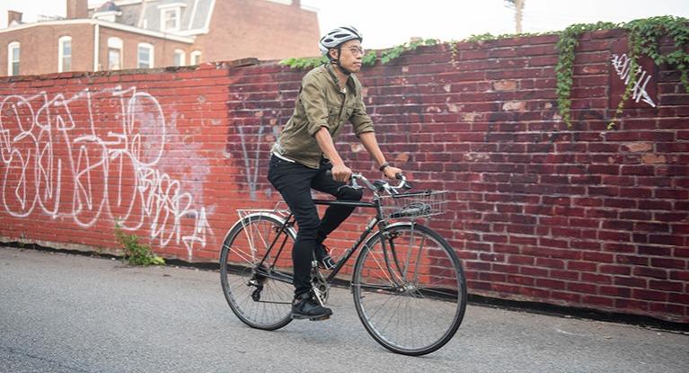 Person riding a commuter bike.