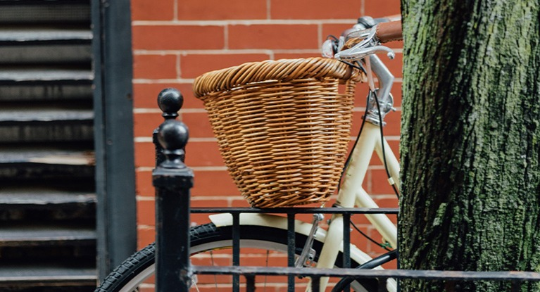 A basket on a bike.