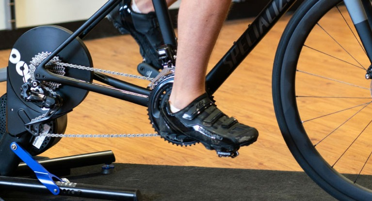 Man riding indoor bike with indoor shoes
