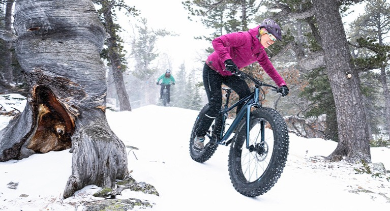 Rider on a fat bike in the snow