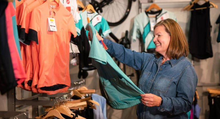 Woman shopping for cycling jersey