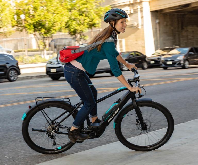 Girl riding bike with racks