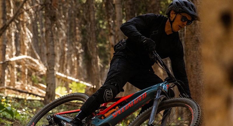 Mountain biker on a wooded trail
