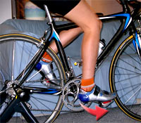 Step down to click into clipless pedals and twist your heels outward (arrow) to get out!