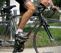 Road bicycle shoes are stiff and light with little if any tread!