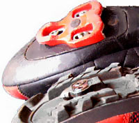 Notice how the walkable shoe (bottom) has a much smaller cleat that's recessed in the shoe sole while the road shoe's cleat protrudes (top).