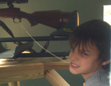 Peyton Kelly's shooting rig was a string attached to the trigger that he fired by pulling with his teeth.