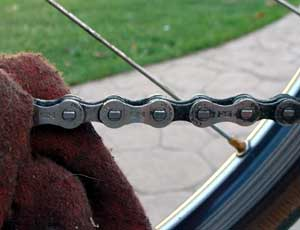 To clean a bicycle chain, wipe the links clean.