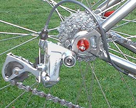 Pull back the rear derailleur by hand for easy wheel removal/installation.