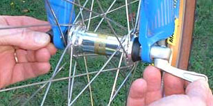 Unscrew the quick release to clear the fork wheel-retention tabs.