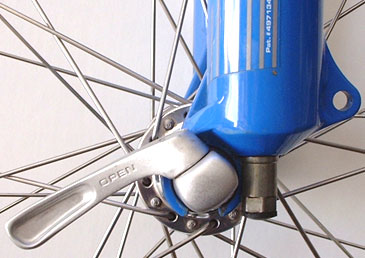"Read the quick-release lever to tell if it's safe. If it reads ""Open,"" the wheel can come off!"
