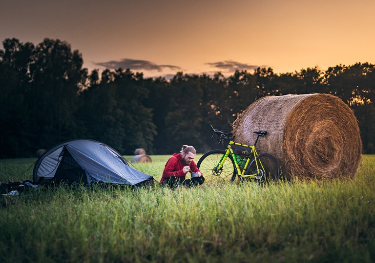 person with bike and tent