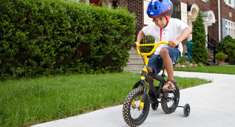 Boy on 12-inch kids' bike