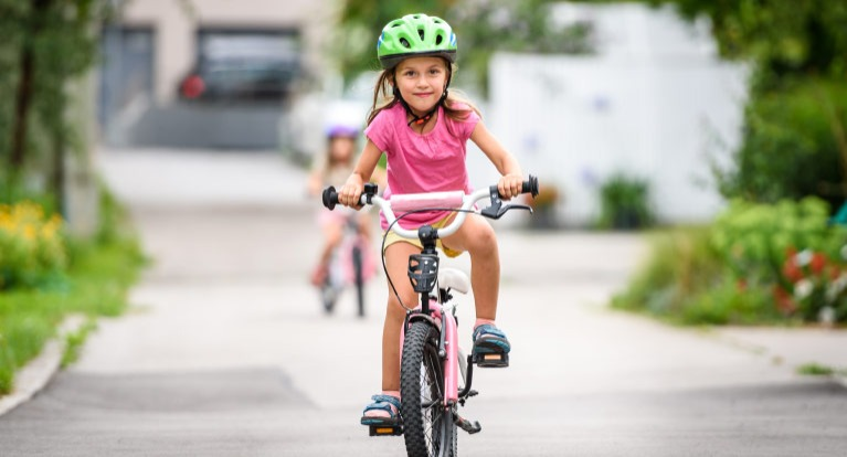 Girl on 16-inch kids' bike