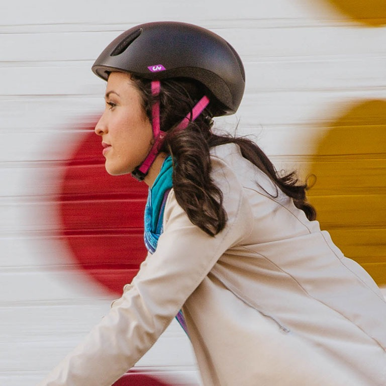 Rider wearing a bicycle helmet
