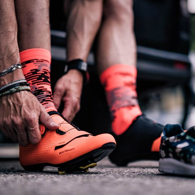 Rider putting on cycling shoes