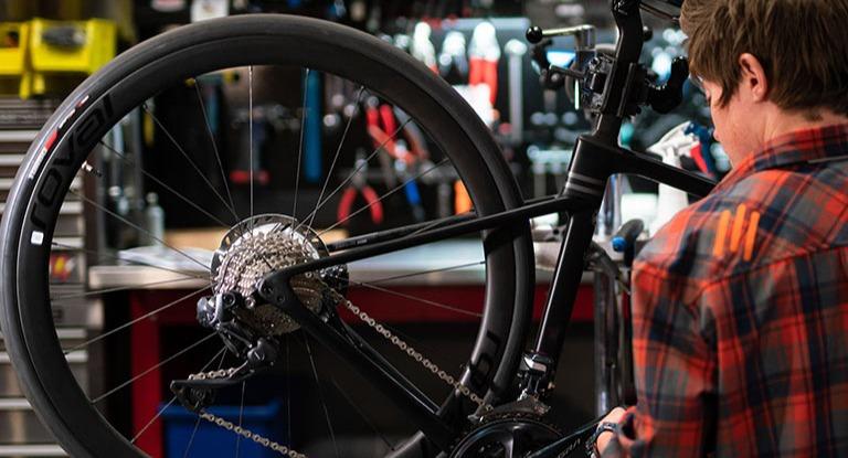Bicycle technician working on a bike