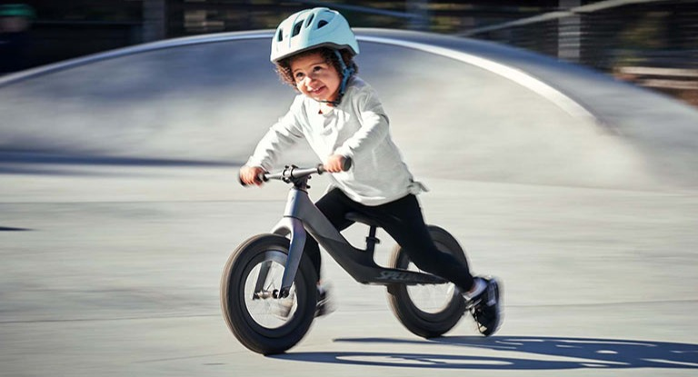 kid riding strider bike