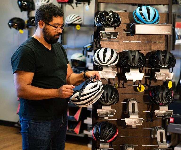 customer looking at helmets