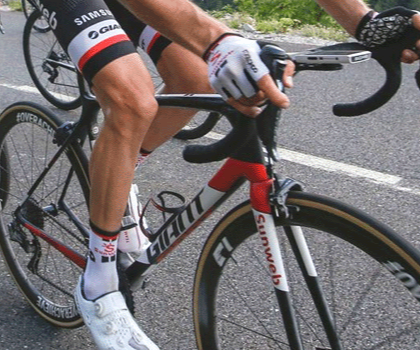 Man riding a Gian TCR Advanced bike on road