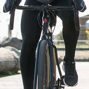A man riding a bike in cool weather wearing bike tights