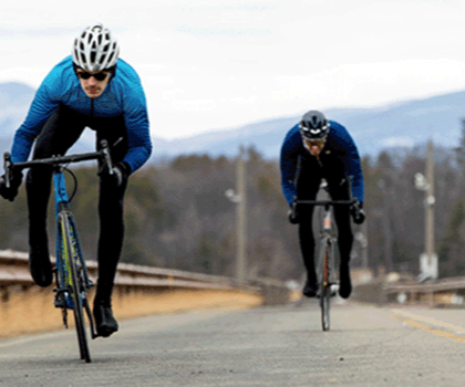 2 men riding a Cannondale SuperSix bike