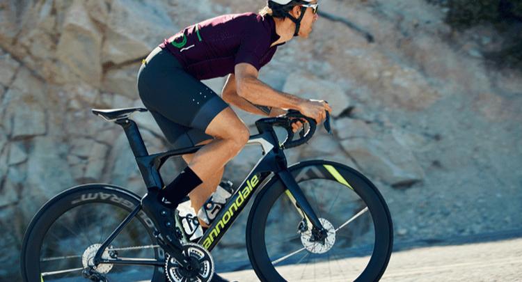 Man riding a Cannondale Road bike