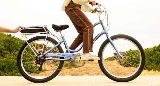 Person riding an Electra Townie Go electric bike