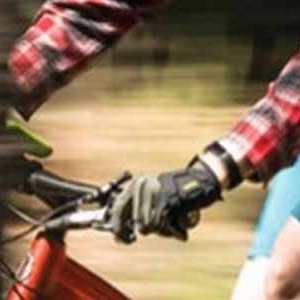 A bike rider wearing long fingered bicycle gloves