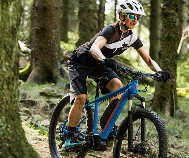 Woman Bike Rider on a Cannondale Mountain Bike in Forest