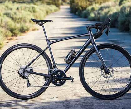 The Giant Contend AR all road bike in the middle of a trail