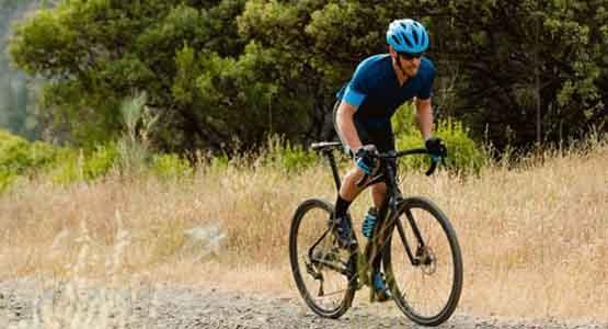 A man riding a Giant Revolt bike on a trail