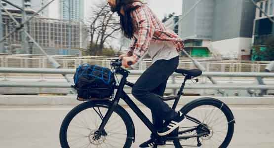 Man riding Cannondale Treadwell Neo electric bike in the city