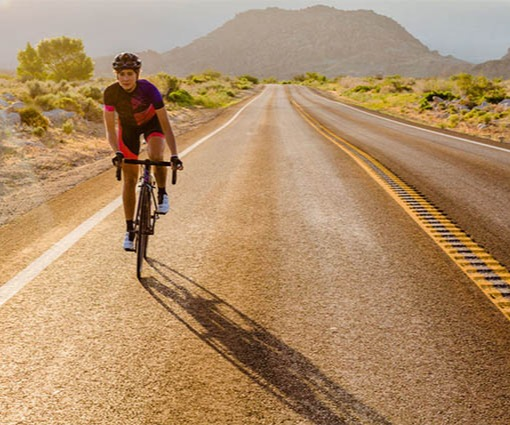 Woman on Liv Road Bike on Long Road