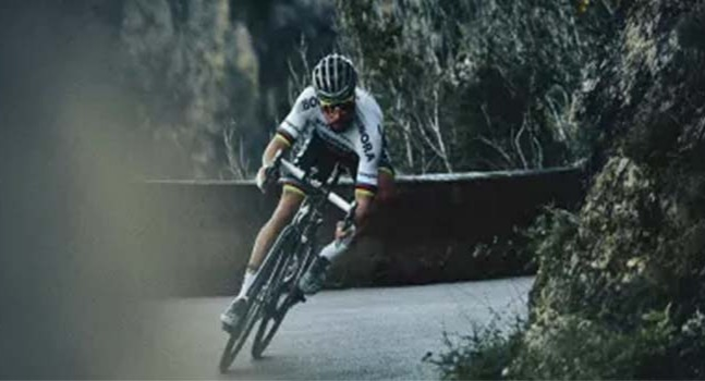 Man with helmet riding a Specialized Roubaix Comp Di2