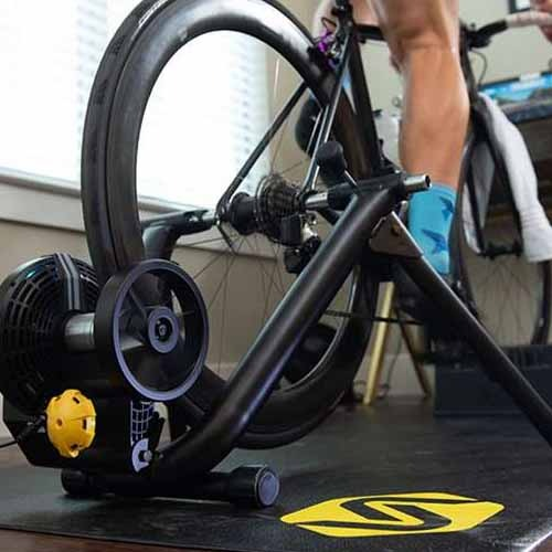 A person riding a bike on a Saris indoor trainer