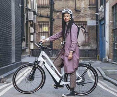 A Woman on a Specialized Electric Bike in the City