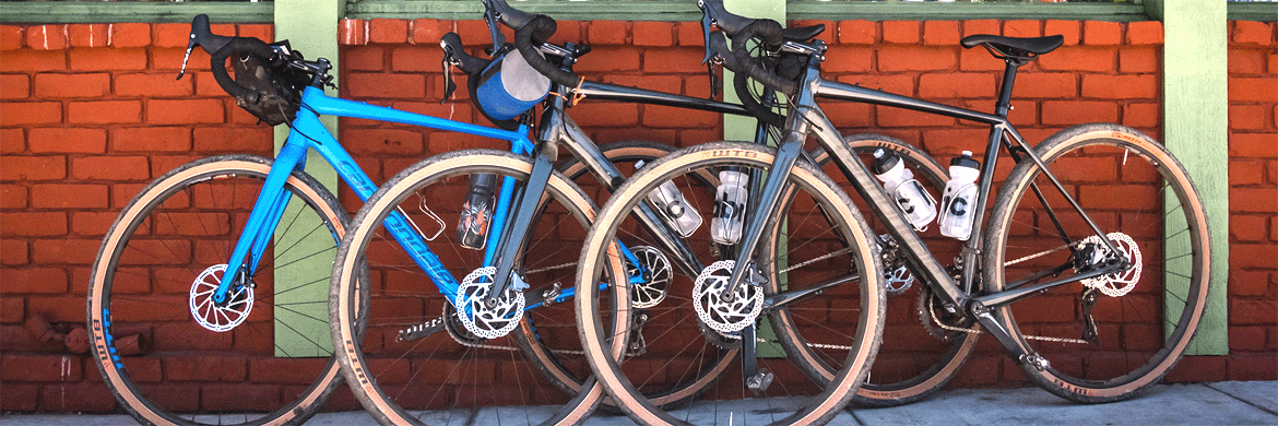 3 Cannondale Topstone bikes leaning against a brick wall