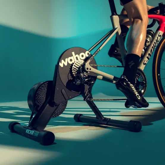 A person training on a Wahoo indoor trainer bike