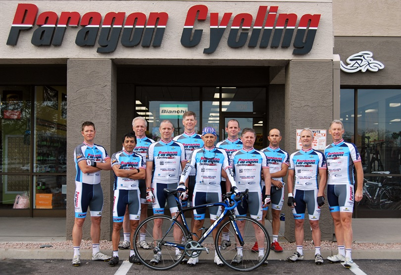 Paragon Cycling team in front of store