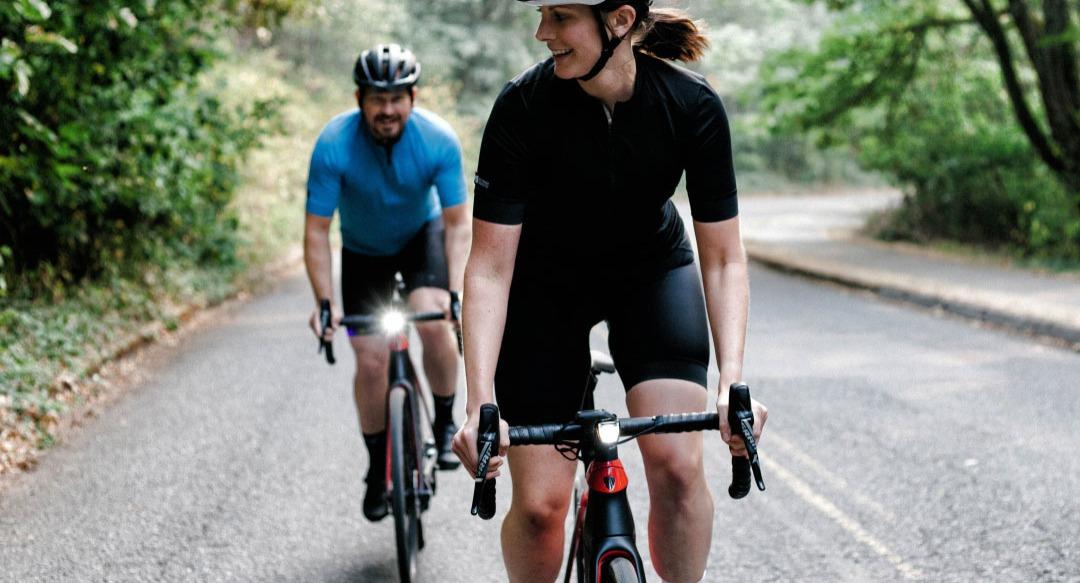 Couple riding road bikes