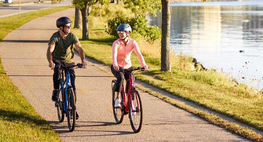 Couple riding on bike trail