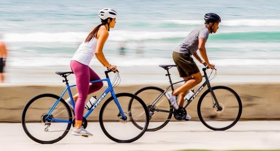 Couple riding hybrid bikes