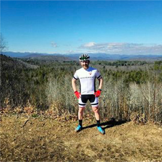 Trek Bike Store Employee Jason on top of the world in DuPont Forest.