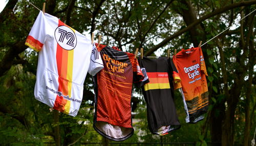 Orange Cycle jerseys on a clothes line